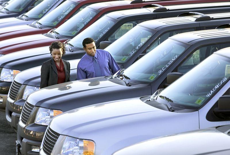 Couple buying SUV