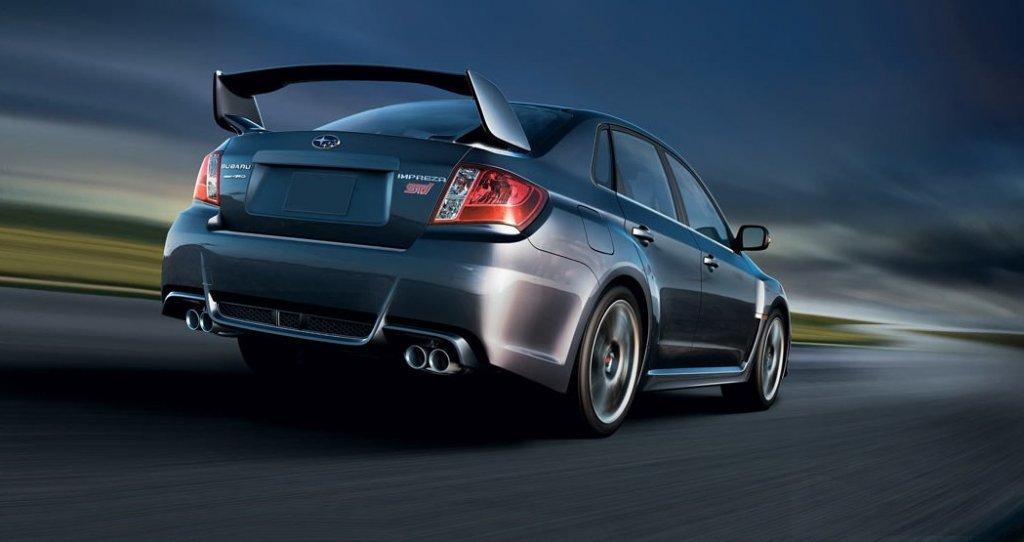 "305-hp turbocharged sedan runs ""wide and low."""