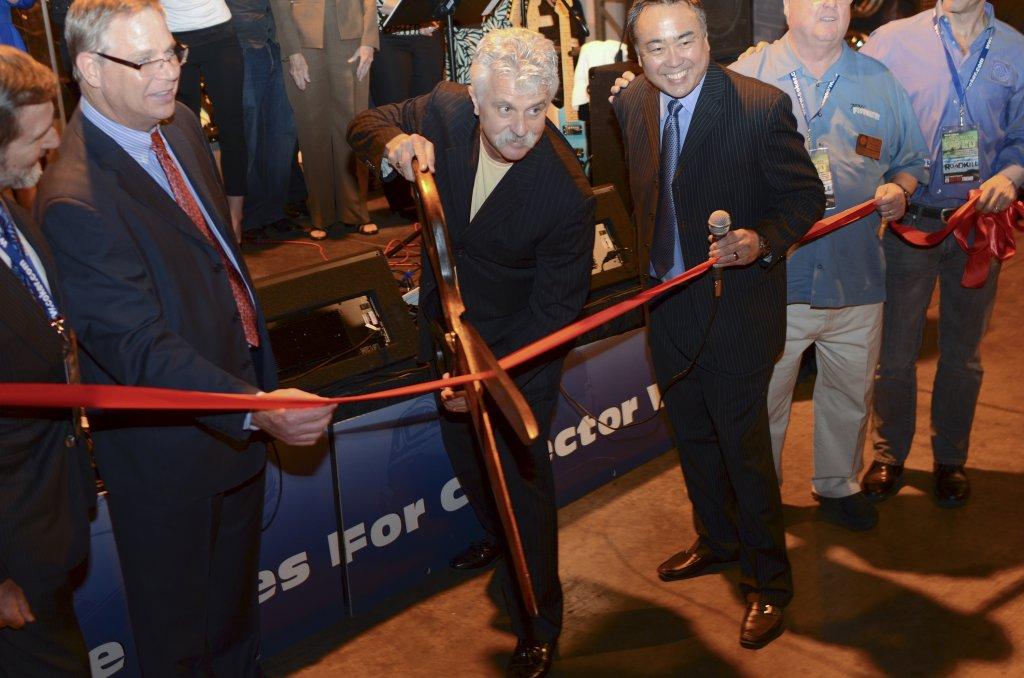 Corky Cutting Ribbon at Grand Opening