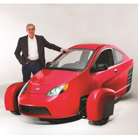 Paul Elio, founder and CEO of Elio Motors, with the P5 prototype of the Elio, a three-wheeled vehicle that will get up to 84 MPG