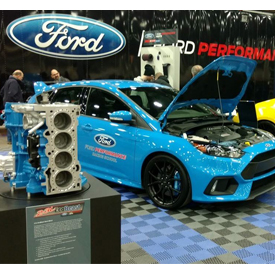 """The Ford """"EcoBeast"""" engine in front of the 2016 Ford Focus RS"""