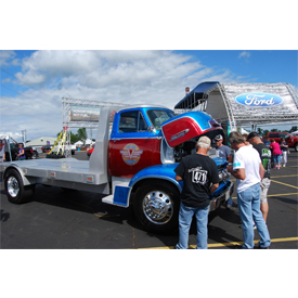 Behind the Vintage Works truck can be seen the Ford Motors Co. booth at the Iola Car Show