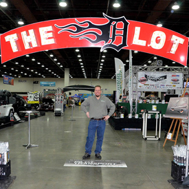 Murray Pfaff stands behind The D Lot sign before Detroit Autorama opened Feb. 26