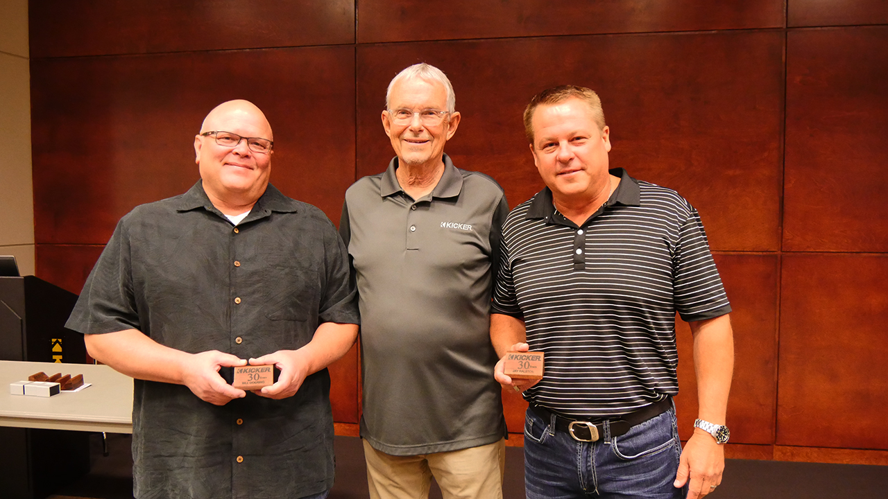 Stillwater Designs employees Bill Doering (left) and Jay Ralston (right) received their 30-year service awards from President St