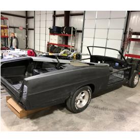 Car in progress at Classic Recreations' new restoration center