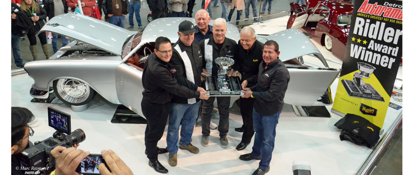 Ridler Award being shown to the crowd gathered to photograph and offer congratulations. From L to R: Tony D'Amato (Meguiar's spo