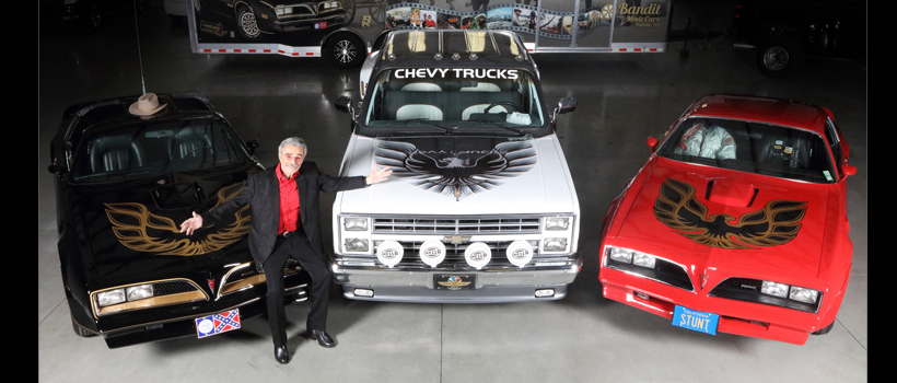 Burt Reynolds poses with three out of four cars going to auction Sept. 29 at a Las Vegas Barrett-Jackson event