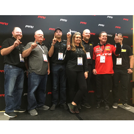 Team Elite Motorsports poses following a press conference at the Dec. 6-8 PRI Show in Indianapolis