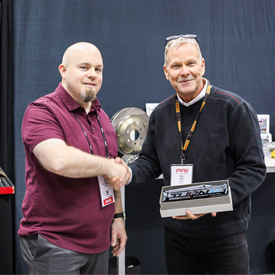 A StopTech representative accepted the Supplier of the Year Award from Turn 14 Distribution at the Dec. 6-8 PRI Show in Indianap
