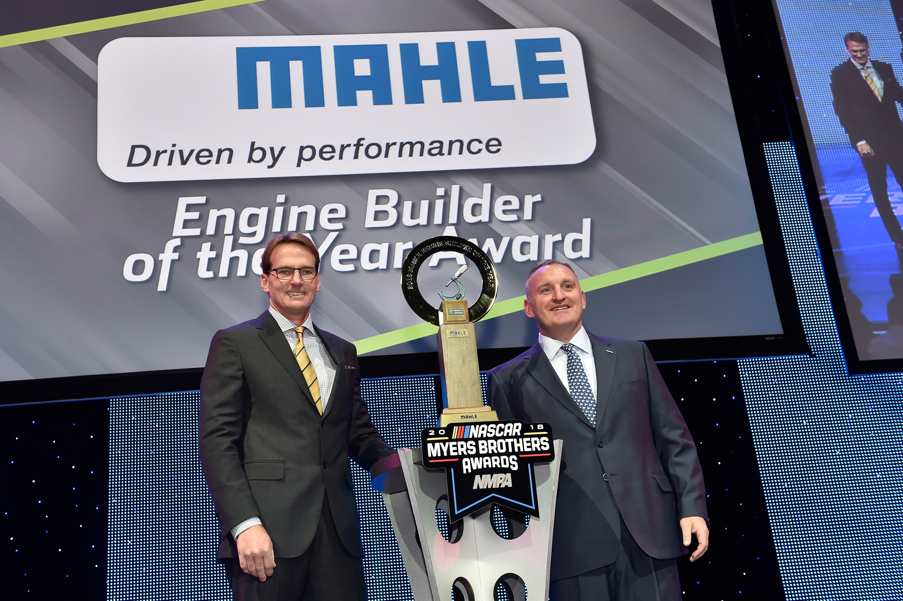 Doug Yates (left), of Roush Yates Engines accepts the MAHLE Engine Builder of the Year Award for the Monster Energy NASCAR Cup S