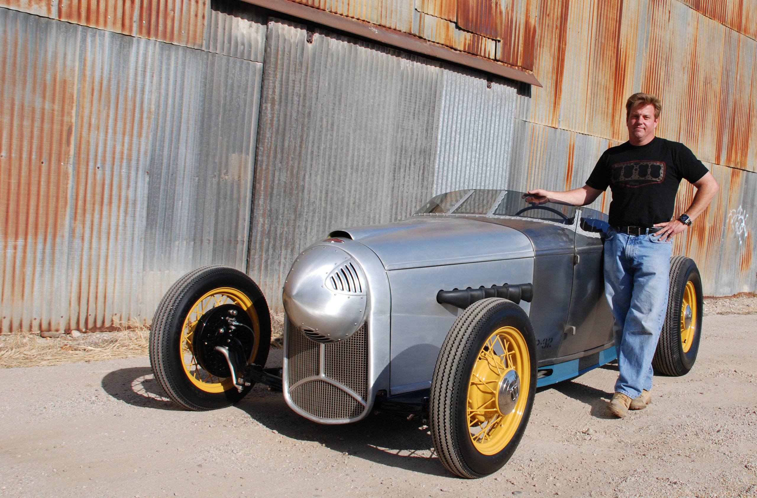 Chip Foose poses with the WWII fighter plane-inspired 1932 Ford Roadster, nicknamed P-32
