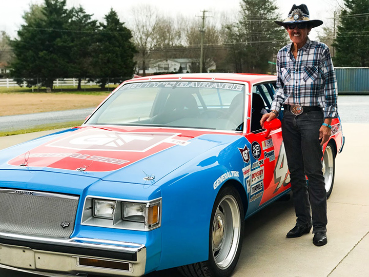 """The King"" Richard Petty stands next to the replica of his storied 1981 Buick Regal"