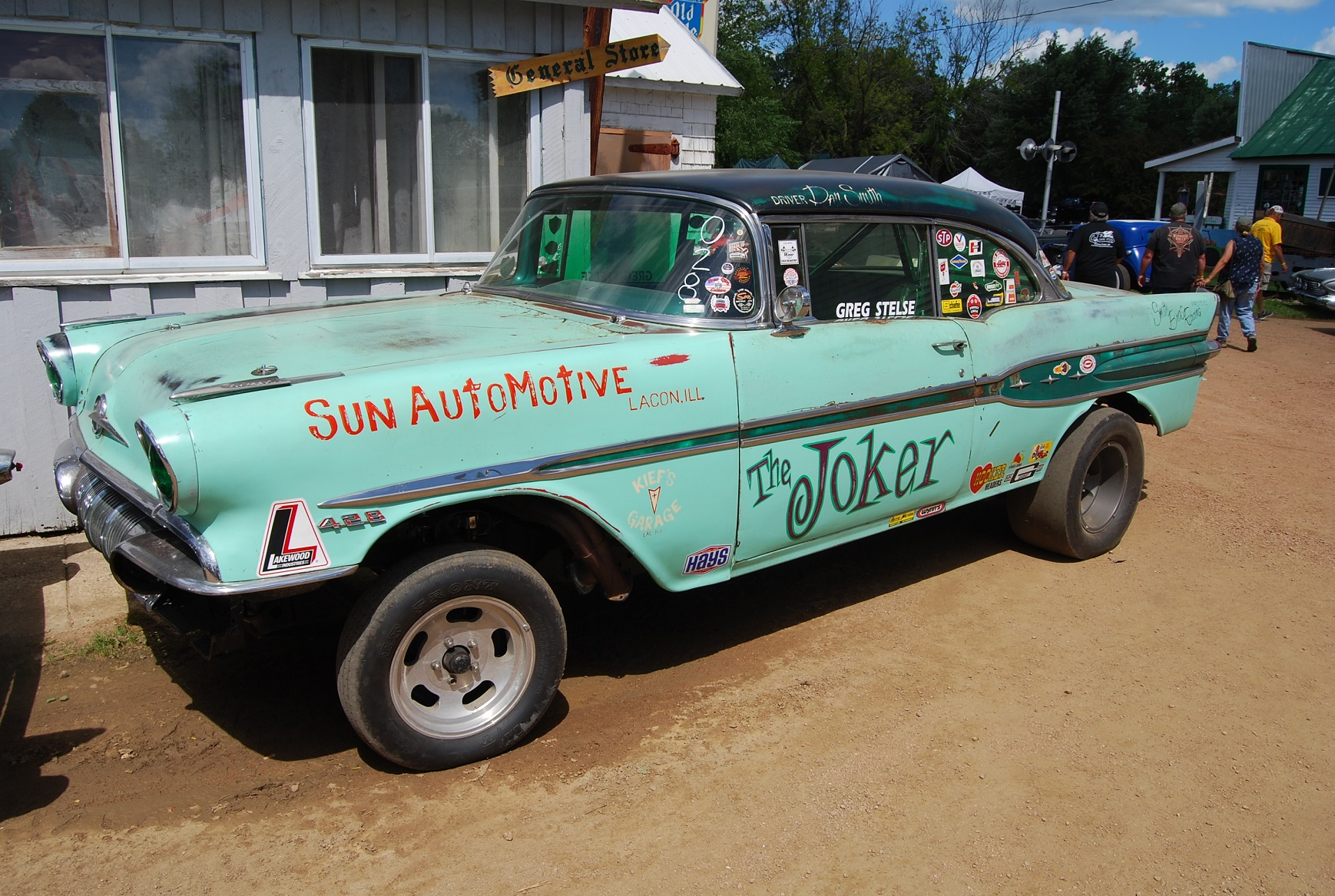 "Greg's Speed Shop featured a 1957 Chevy a 1957 Pontiac drag racer and its Green Pontiac Star Chief  called ""The Joker""  at the S"