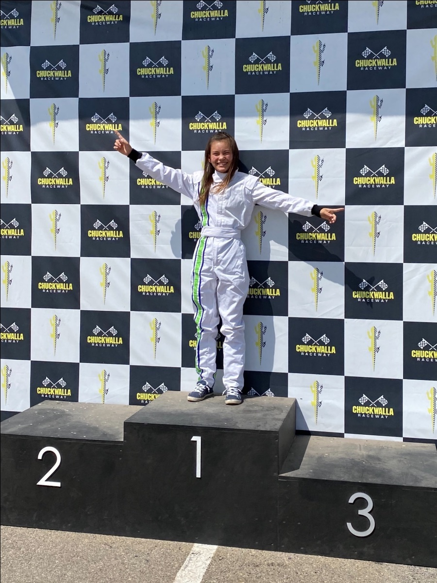 girl racing STEM podium